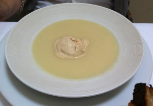 Cream of white asparagus soup with foie gras ice cream